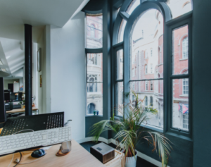 Interior of Spenbeck creative space overlooking Broadway, The Lace Market, through large restored windows