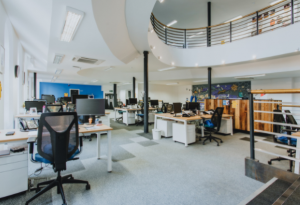 Large airy creative office space with an open-plan design, flooded with natural light