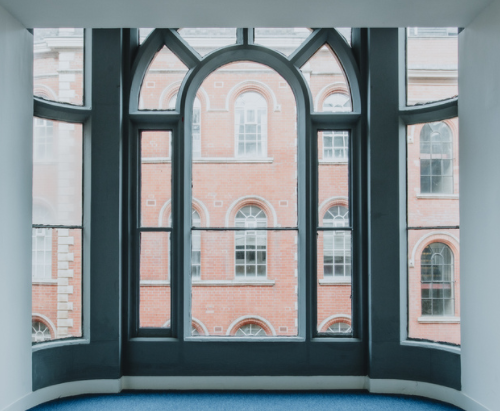 Large bay window overlooking Victorian buildings beyond in Nottingham's Lace Market
