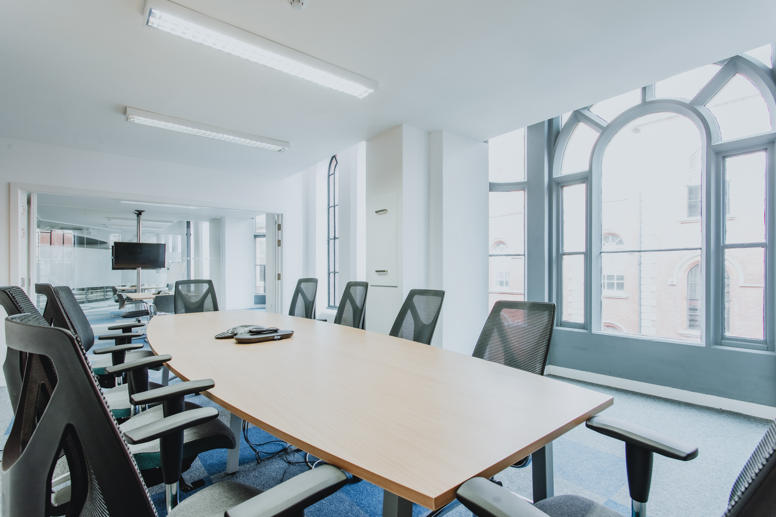 Board room and collaboration desk against big window Spenbeck creative space offices to rent Nottingham